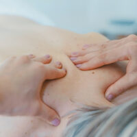 patient receiving massage therapy