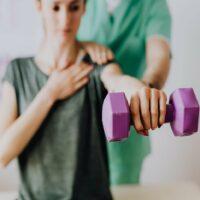 osteopath helping woman